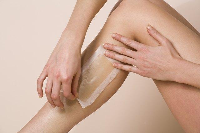 Woman waxing leg