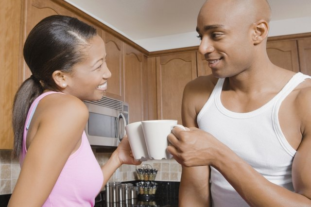 African couple drinking coffee