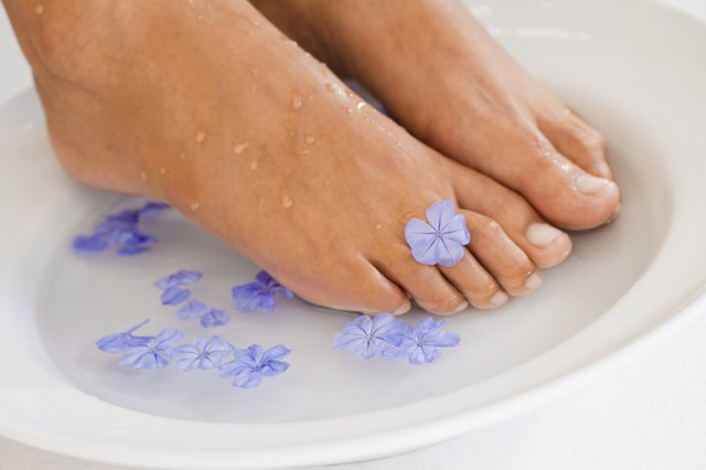 Soaking feet in water with flowers