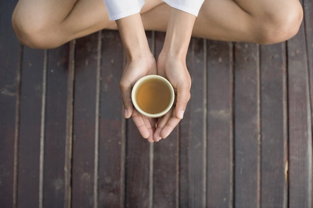 Woman's hands holding tea