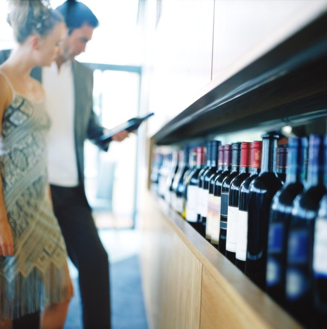 shot of a young couple choosing wine