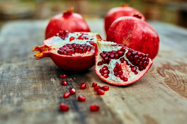 pomegranates on a dark wooden background