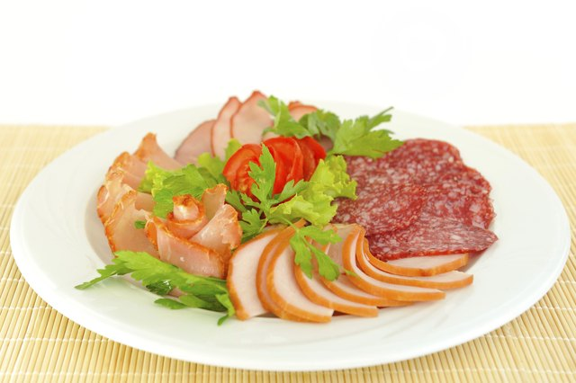 Dish with pastrami and salami slices.