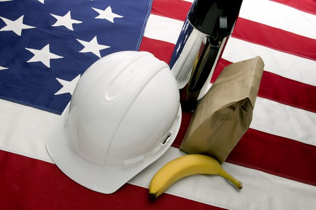 Hard hat, thermos, sack lunch and American flag
