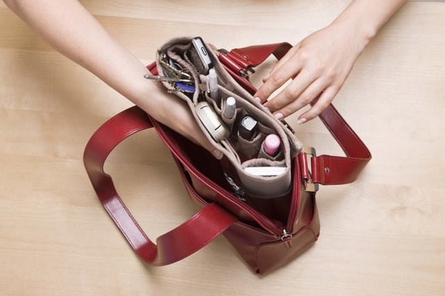 Hands searching in handbag