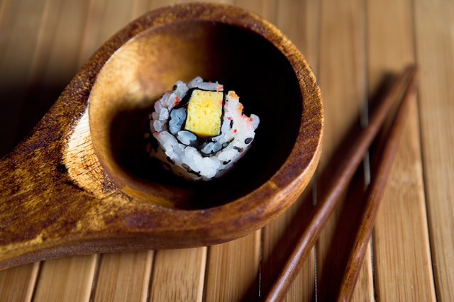 Sushi roll in wooden bowl