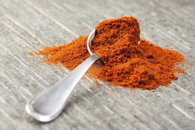 ground paprika on a spoon