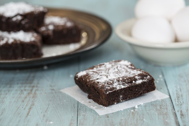 Brownies With Powdered Sugar with a Bowl of Eggs