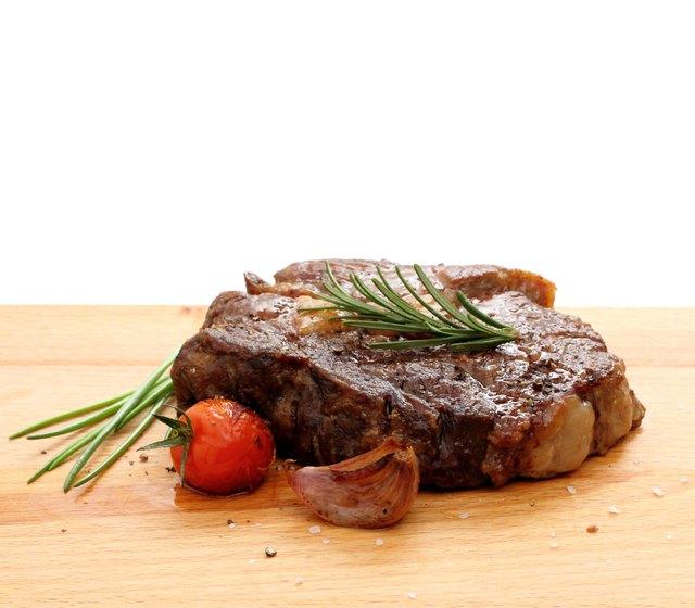 Steak rib-eye garnished with grilled