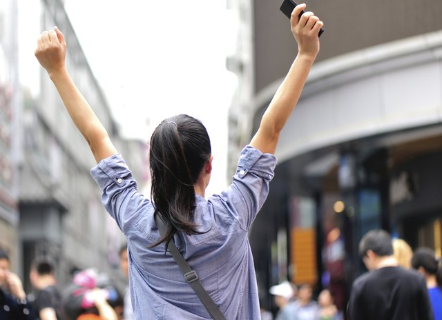 cheering woman on the street