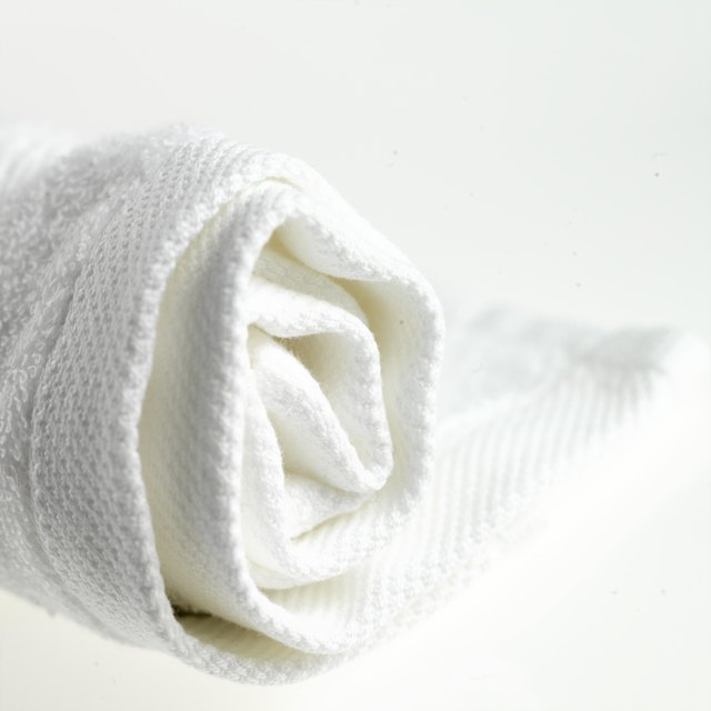 Rolled-up white towel, close up