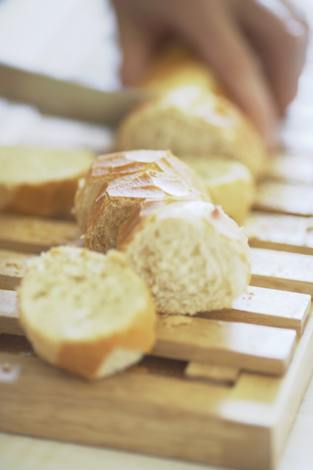 High angle view of a person cutting bread on a cutting board