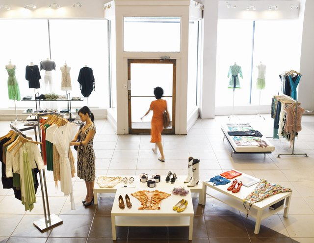 Female shoppers shopping in retail boutique