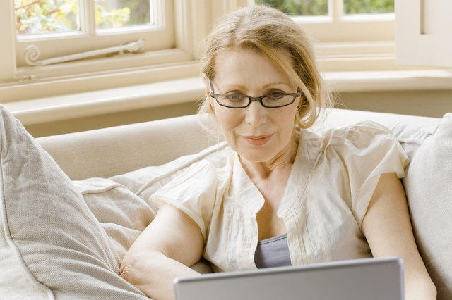 Woman with eyeglasses and laptop computer