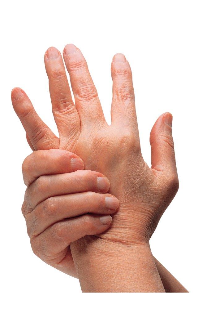 Hands rubbing in pain