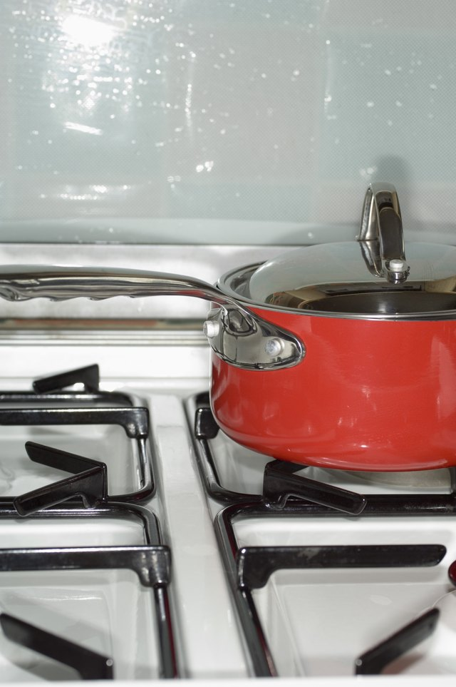 Pot with lid on stove top