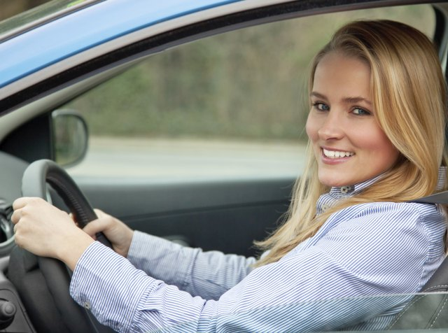 Attractive woman driving her car