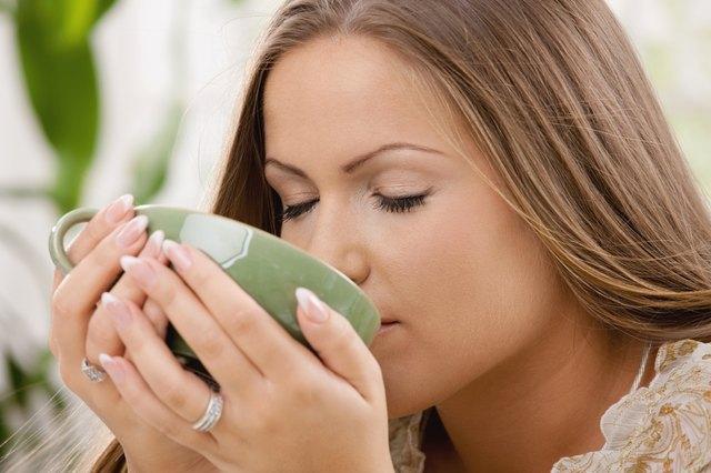 Beautiful girl drinking tea