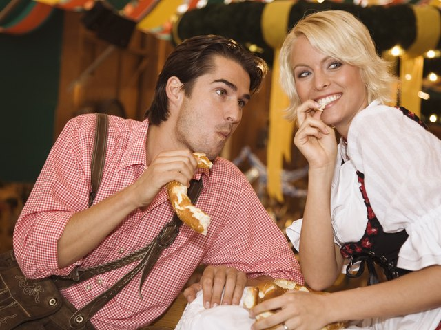 Couple eating pretzel
