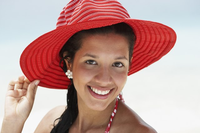 South American woman wearing sunhat