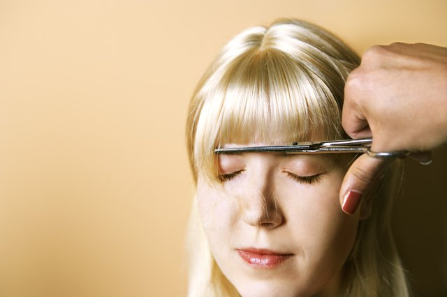 Woman getting bangs cut