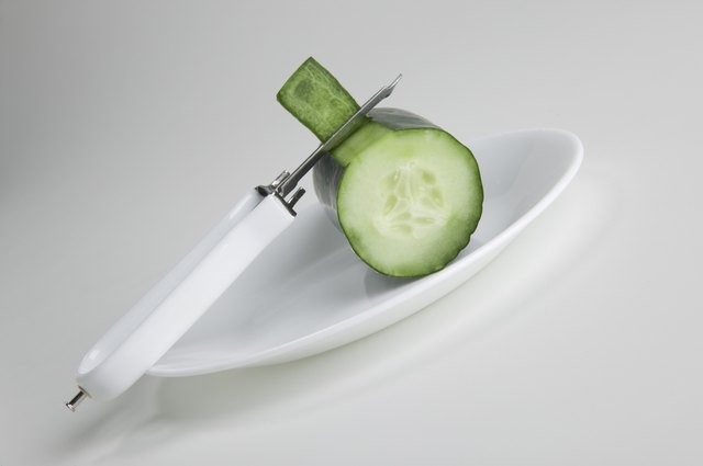 A cucumber being peeled