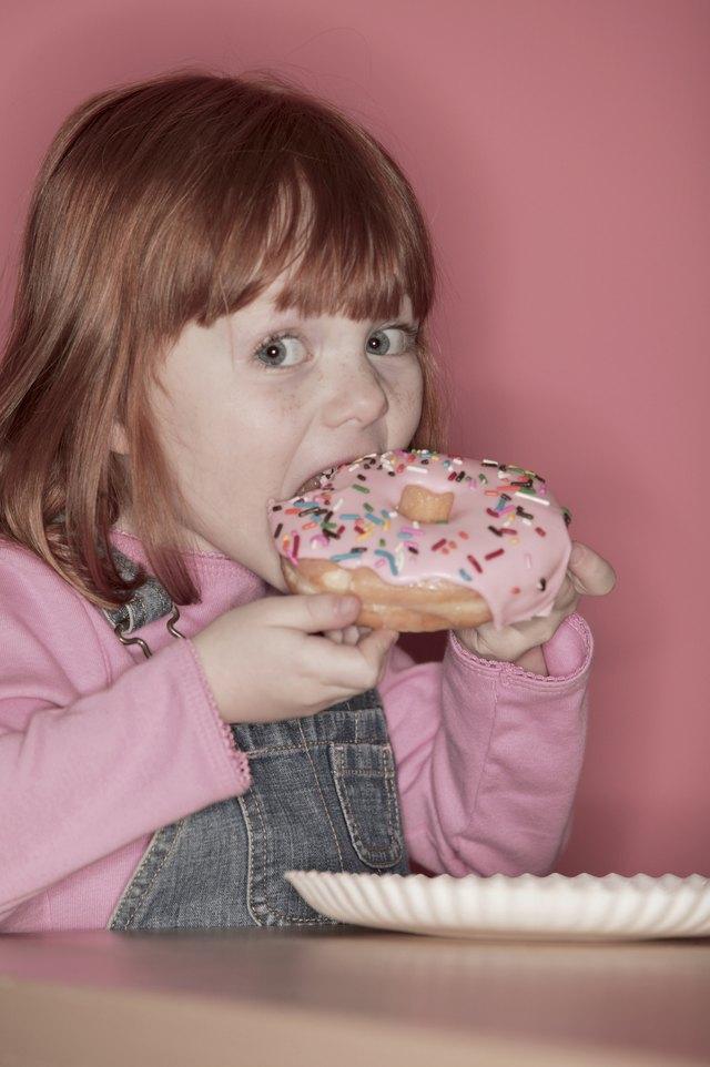 Girl eating doughnut