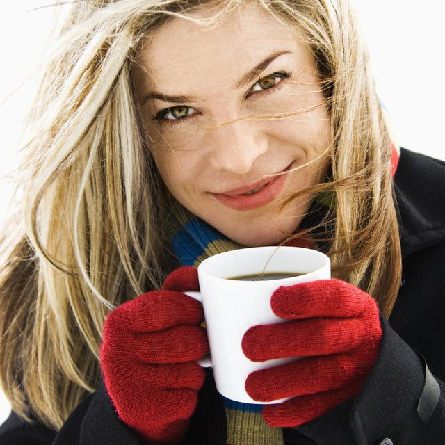 Woman holding mug of hot cocoa