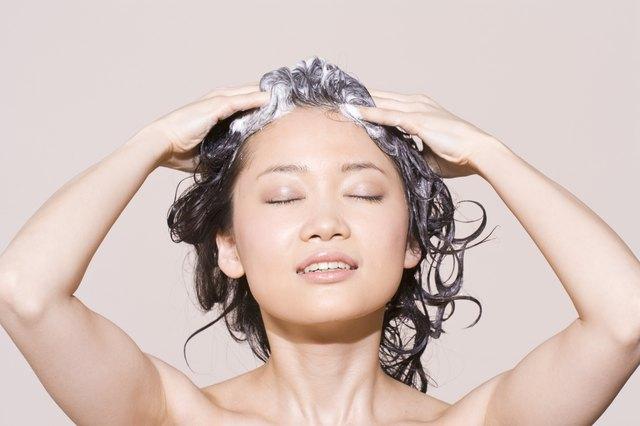 Woman lathering shampoo