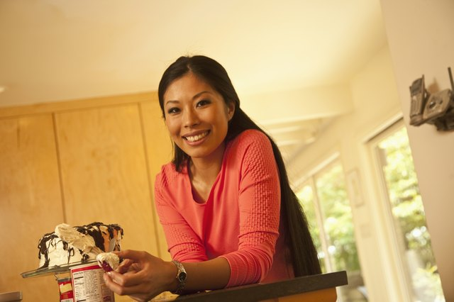 woman frosting cake