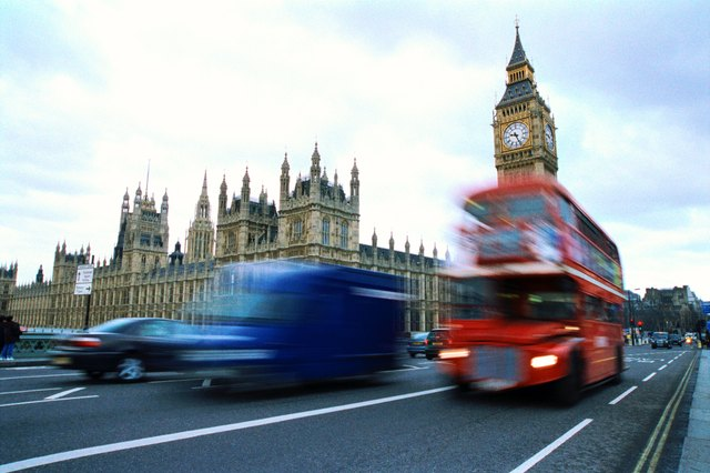 Traffic moving on a street in front of big Ben