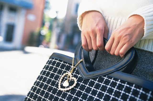 Young Woman Holding A Hand Bag Close Up