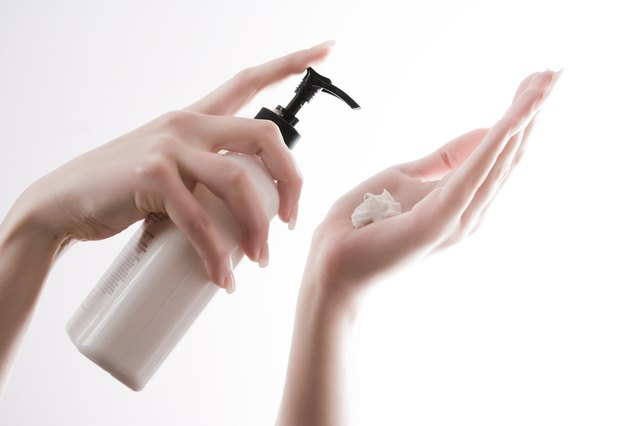 Woman pumping lotion into hands