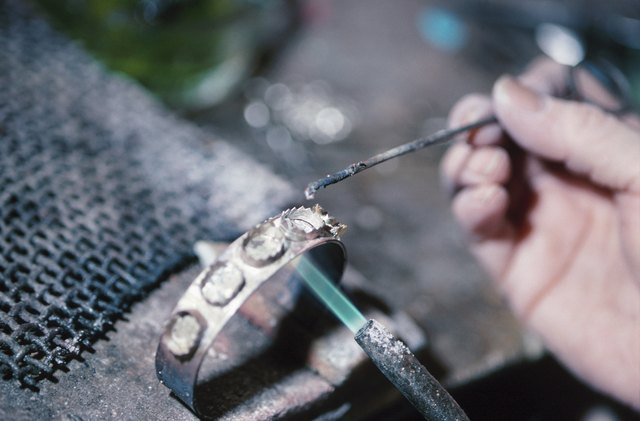 Close up of a welder making a bracelet