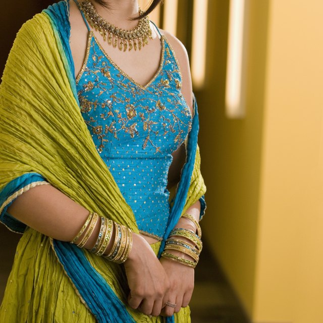 Mid section view of a woman wearing salwar suit