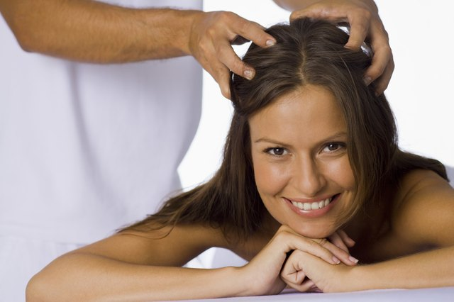 Woman having a scalp massage