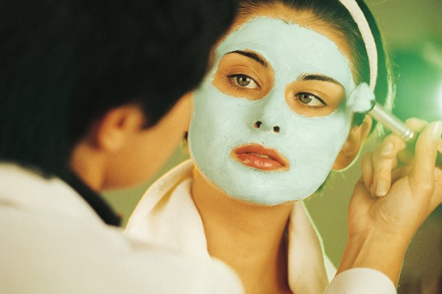 Woman having face mask applied