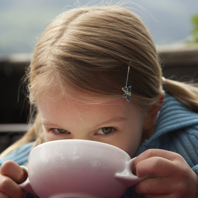 Girl Drinking from Soup Bowl