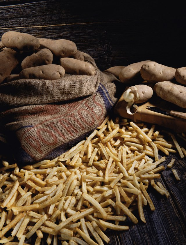 Potatoes in a sack next to French fries