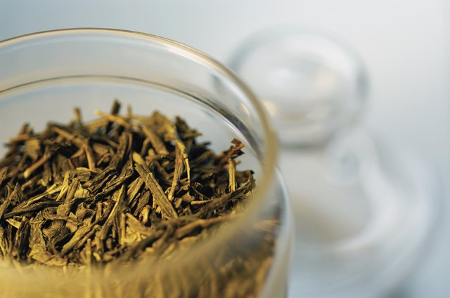 Tea leaves in an open glass container