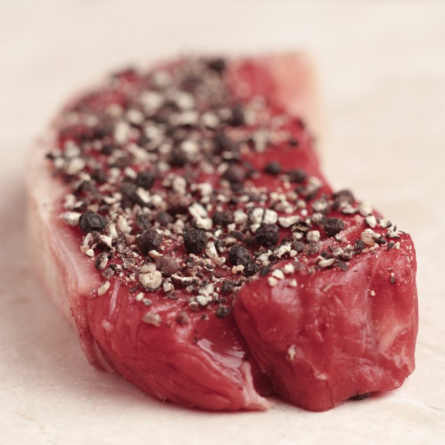 Cut of red meat sprinkled with spices