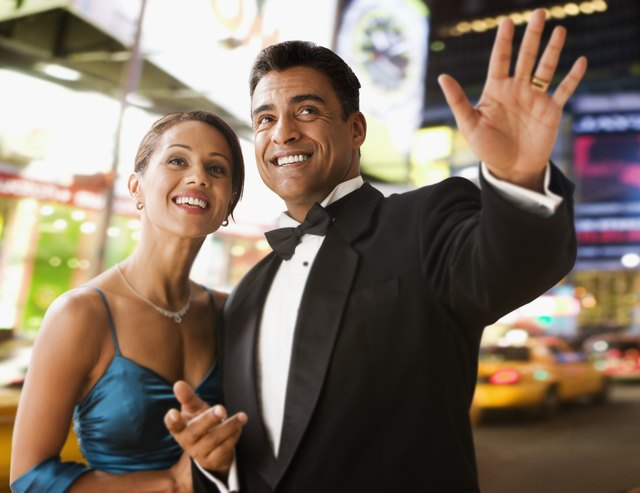 Hispanic couple in eveningwear in urban scene