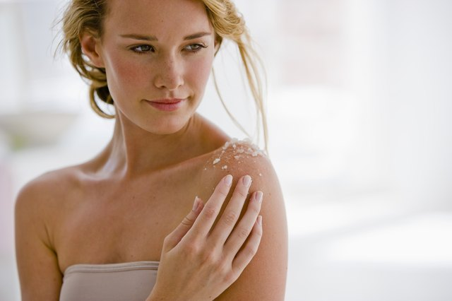 Woman using body salts