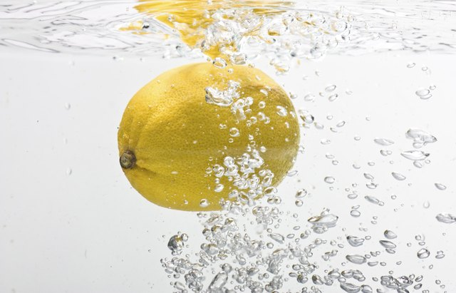 Lemon dropped into water