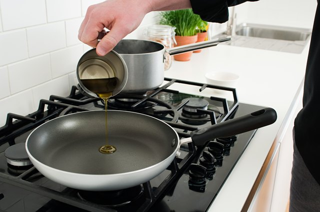 Man pouring cooking oil into frying pan