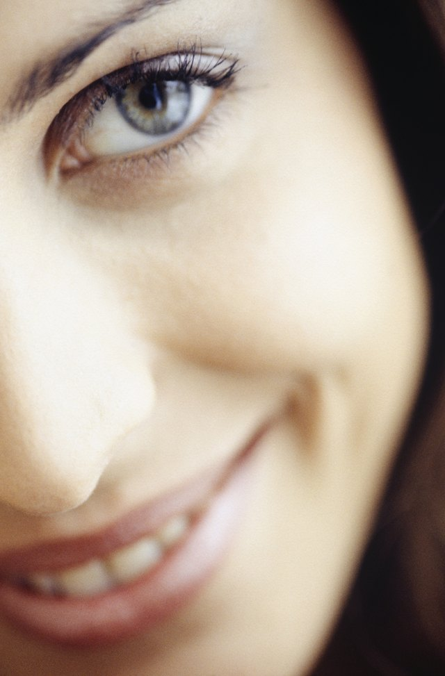 Young woman smiling, (close-up), (portrait)