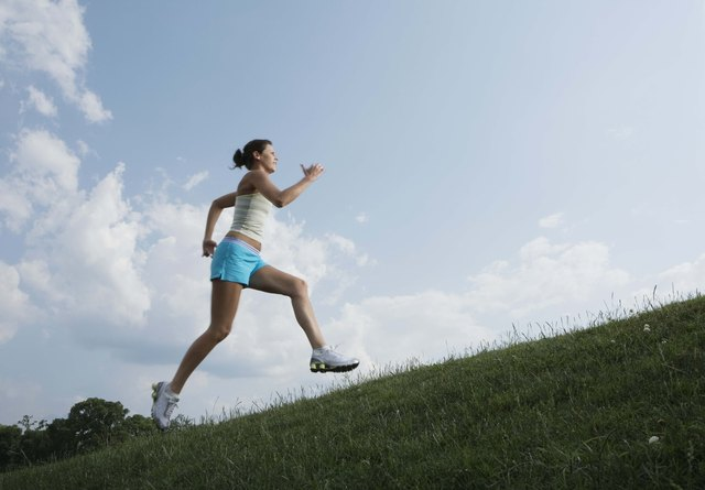 Woman running on hillside