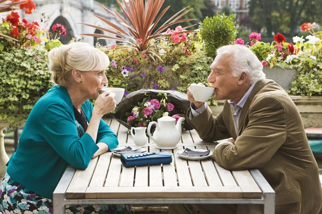 Couple drinking tea outdoors