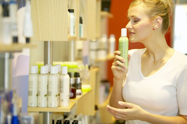 Woman smelling skincare cream
