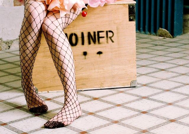 Young woman wearing net stockings
